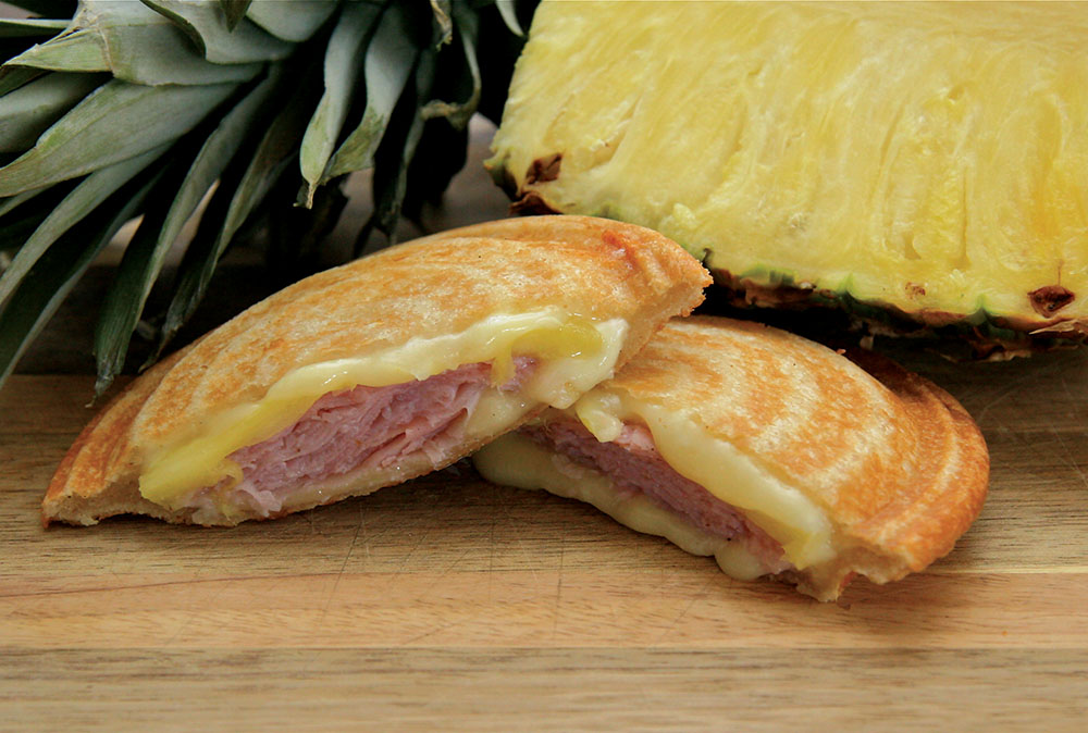 Toas-Tite Pie Iron Camping or Kitchen Recipes. Tropical Ham and Cheese. Ham. Swiss Cheese. Pineapple. Toast about 1-1/2 minutes. Luau.